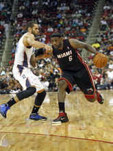 Charlotte Bobcats' Jeffery Taylor guards Miami Heat's LeBron James (6) during the second half of an NBA preseason basketball game in Raleigh, N.C., Tuesday, Oct. 23, 2012. Miami won 98-92. (AP Photo/Gerry Broome)