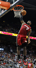 Miami Heat forward LeBron James (6) dunks in the first half of a preseason NBA basketball game against the Atlanta Hawks, Sunday, Oct. 7, 2012, in Atlanta. (AP Photo/Todd Kirkland)