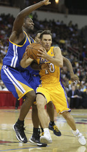 Los Angeles Lakers' Steve Nash, right, drives against a Golden State Warriors defender in the first half of a preseason NBA basketball game in Fresno, Calif., Sunday, Oct. 7, 2012. (AP Photo/Gary Kazanjian)