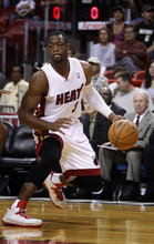 Miami Heat's Dwyane Wade during the first half of a NBA basketball game in Miami, Saturday,Oct. 20, 2012 against the San Antonio Spurs. (AP Photo/J Pat Carter)