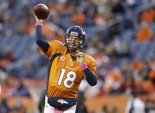 Denver Broncos quarterback Peyton Manning (18) warms up before playing the New Orleans Saints in an NFL football game, Sunday, Oct. 28, 2012, in Denver. (AP Photo/Jack Dempsey)
