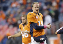 Denver Broncos quarterback Peyton Manning (18) stretches before playing the New Orleans Saints in an NFL football game, Sunday, Oct. 28, 2012, in Denver. (AP Photo/Jack Dempsey)