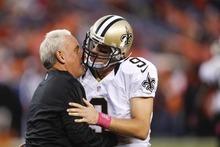 New Orleans Saints interim head coach Joe Vitt, left, talks with quarterback Drew Brees (9) before playing the Denver Broncos in an NFL football game, Sunday, Oct. 28, 2012, in Denver. (AP Photo/David Zalubowski)