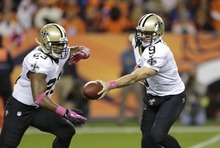 New Orleans Saints quarterback Drew Brees (9) hands the ball off to New Orleans Saints running back Pierre Thomas (23) in the first quarter of an NFL football game against the Denver Broncos, Sunday, Oct. 28, 2012, in Denver. (AP Photo/Jack Dempsey)