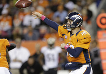 Denver Broncos quarterback Peyton Manning (18) throws against the New Orleans Saints in the first quarter of an NFL football game, Sunday, Oct. 28, 2012, in Denver. (AP Photo/Jack Dempsey)