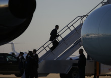 President Barack Obama is seen walking up the steps of Air Force One as he boards Air Force One at Orlando International Airport, Monday, Oct. 29, 2012 in Orlando Fla. Obama is canceling a morning campaign rally in Orlando to return to Washington to monitor the preparation for early response to Hurricane Sandy.(AP Photo/Pablo Martinez Monsivais)
