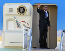 President Barack Obama waves as he boards Air Force One before departing the Orlando International Airport, Monday, Oct. 29, 2012, in Orlando, Fla., enroute to Washington to monitor Hurricane Sandy.  (AP Photo/John Raoux)