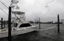 Charter boat fishermen secure boats in the blowing rain at Broad Creek Marina in Wanchese, N.C., Sunday, Oct. 28, 2012, as Hurricane Sandy moves up the East Coast. (AP Photo/Gerry Broome)