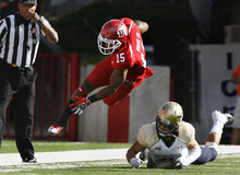 Scott Sommerdorf  |  The Salt Lake Tribune              Utah RB John White IV is sent airborne on this tackle during early first quarter play. Utah held a 7-0 lead over Northern Colorado early in the second quarter on Jordan Wynn's 10-yard TD pass to Jake Murphy, Thursday, August 30, 2012.