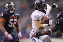 Utah State receiver Cameron Webb eludes UTSA defender Darrien Starling (24) en route to a touchdown  during an NCAA college football game on Saturday, Oct. 27, 2012, in San Antonio, Texas. (AP Photo/San Antonio Express-News, Billy Calzada) RUMBO DE SAN ANTONIO OUT; MAGazineS OUT; TV OUT; NO SALES; SAN ANTONIO OUT; AP MEMBERS ONLY; MANDATORY CREDIT